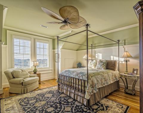 A Bedroom With A Beautiful Oriental Area Rug From RugKnots.com